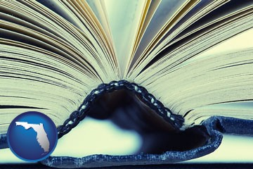 a hardcover book spine (macro photo) - with Florida icon
