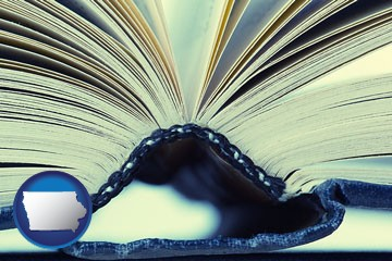 a hardcover book spine (macro photo) - with Iowa icon