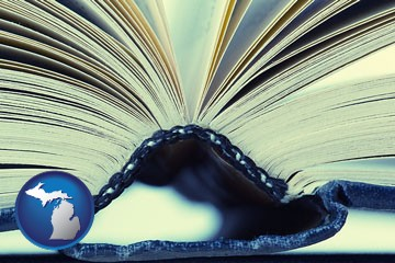 a hardcover book spine (macro photo) - with Michigan icon
