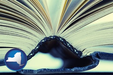 a hardcover book spine (macro photo) - with New York icon