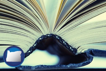 a hardcover book spine (macro photo) - with Oregon icon
