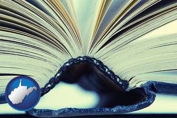 a hardcover book spine (macro photo) - with West Virginia icon
